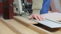 carpenter cutting wood panel circular saw (SawAdvisor) Tags: circular saw woodworking carpenter cutting circularsaw