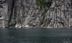 Norweigan ([CamCam]) Tags: norway norweigan boat yacht rock rocks cliff water fjord close crop red blue green camcam