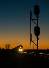 Sunrise Manifest - East of Gothenburg, NE (Christopher J May) Tags: train railroad sunrise sky unionpacific uprr signal silhouette gothenburg nebraska ne nikoned800 nikonafnikkor80200mmf28d