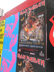 Suspiria 2018 movie poster and Iron Maiden Poster 5263 (Brechtbug) Tags: iron maiden concert poster blue construction fence eddie devil monster zombie album british heavy metal skeletal sidekick west 45th street nyc 2018 november 11182018 brit soldier creepy demon dude union jack flag torn billboard posters billboards cover art suspiria movie