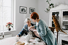 cozy morning (Yuliya Bahr) Tags: love family together parents cat elderly tea morning breakfast kitchen white cozy pets funny home sweethome social socialdocumentary grain