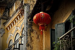 Old Hanoi (The Spirit of the World ( On and Off)) Tags: hanoi vietnam seasia colonialperiod frencharchitecture shutters wroughtiron balcony windows facade lantern redlantern plants old historical home plantationhouse
