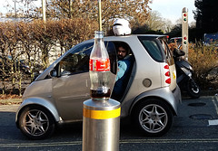 TLOP: cola bottle and helmet (amazingstoker) Tags: tlop things left posts coca cola bottle stainless steel smart motor cycle helmet basingstoke amazingstoke basingrad hampshire seal road new car parked scooter deliveroo