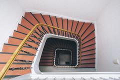 Staircase XXIV (chris-tik) Tags: treppe stufen steps stairs staircase stairwell stairway stair samyang 12mm fuji symmetry symmetrie room lübeck wood architecture wall escala escalera architektur architectural orange