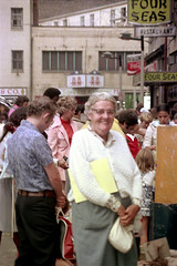 71-108 (ndpa / s. lundeen, archivist) Tags: nick dewolf nickdewolf color photographbynickdewolf 1975 1970s film 35mm 71 reel71 boston massachusetts july summer festival artsfestival summerthing citylife downtown chinatown people woman oldwoman nanny glasses eyeglasses hazelisabelmahoneyhuggan huggan huggins hazelhuggan mrshuggan mrshuggins whitehair grayhair purse handbag sign chineserestaurant restaurant fourseas building buildings coke cocacola youngpeople crowd business storefront smile smiling summerthingfestival streetphotography streetlife candid