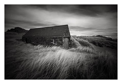 Llanddwyn Boathouse - January 15th (Edd Allen) Tags: wales northwales anglesey llanddwynlighthouse lighthouse snowdonia sea seascape seaside shore shoreline atmosphere sunrise grass wind atmospheric clouds landscape uk nikond810 zeissdistagon 18mm infrared bw blackandwhite