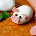 Piglet made from eggs, sausage and pepper peas