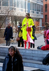 A Ray of Springtime in the Midst of Winter Black - High Line, Chelsea, NYC (TravelsWithDan) Tags: youngwoman colors yellow orange springtime winterdrab springcolors clothing redpurse yellowcoat orangedress redboots sunglasses highline chelsea nyc newyork candid streetphotography city urban