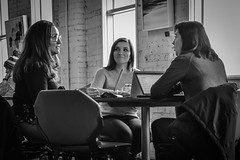 Laptops & Lunch (tim.perdue) Tags: north market columbus ohio downtown urban city short arena district candid street black white bw monochrome nikon d5600 nikkor 18140mm lunch laptop computer macbook women people figures three trio cup chair table girl woman person figure humans