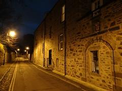 The old road in old Aberdeen (Ian Robin Jackson) Tags: night old aberdeen oldaberdeen scotland building street wall sky blue heraldry lights city urban windows stonework ancient age