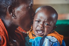 Hush Now Baby (u c c r o w) Tags: baby child mother arusha tanzania black colors colorful love beauty woman africa tanzanian maasai portrait tears crying cry teardrops