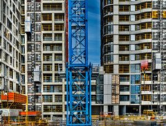 Colourful complex construction site (bunrudwud) Tags: construction building apartments site crane ladder railing elevator colour red blue yellow primary complex scale large intricate work labour nikon d5600