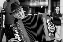 The street musician (2nd take) (Özgür Gürgey) Tags: 2013 50mm bw busyhands d7100 marienplatz münchen nikon accordeon eyecontact musician smileonsaturday street cropped