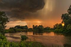 Armageddon now! 2 (piotrekfil) Tags: nature landscape cloud rain wind storm sunset sky water river reflections summer sun pentax poland piotrfil