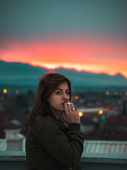 Colors of winter (kisicekpatrik) Tags: colors winter colorsofwinter human cigarette girl smoke sky mountain rooftop cold building sunset houses rural street lights city face eye lips hand camel jacket hair