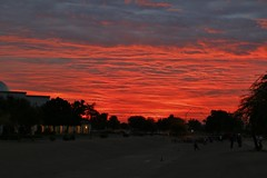 Sun rise in Goodyear Arizona on Thanksgiving. (Explored-Thanks so much everyone!!) (outdoorpict) Tags: sunrise blue clouds red orange church firelike ditch early trees ymca runners