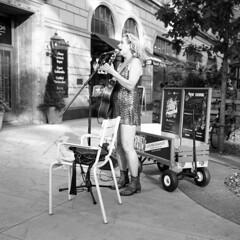 courtney-yasmineh (kaumpphoto) Tags: rolleiflex 120 tlr bw black white ilford perform street urban city music nicolletmall minneapolis dress sequins boots guitar microphone sing chair purse wagon sidewalk blonde wheel legs pick strum nowshowing show live