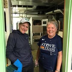 Beth Sheehan and Susie work on Drop in center laundry room