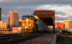 Xtra Low Light (Wheelnrail) Tags: csx csxt train trains dayton ohio toledo subdivison sunset golden skyline urban city gem ge et44ah autorack x27010 buildings bridge spot winter