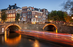 Bridges of Amsterdam IV (Jack Landau) Tags: amsterdam bridges city urban evening fall dusk singel canal lights jack landau canon 5d long exposure road water bridge building tree people sky