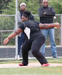 A'Nasia Monford throws discus during the track and field meet.