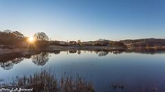 Kalandsvatnet (2000stargazer) Tags: kalandsvatnet bergen hatlestad norway lake reflections october sunrise shadows silh trees sun landscape nature clear canon