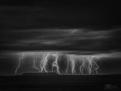 Nothing standing in the way (Dave Arnold Photo) Tags: nm nmex newmex newmexico laguna correo mountains range lightning lightening desert storm stormy thunderstorm thunder image pic us usa picture severe photo photograph photography photographer davearnold davearnoldphotocom nighttime sun scenic cloud rural summer badweather top wet night canon 5d mkiii 100400mm huge big valenciacounty landscape nature monsoon outdoor weather rain rayo cloudy sky cloudburst raincolumn rainshaft season southwest monsoons strike ray monochrome blackwhite bw mesa