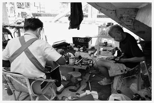 Chiang Mai snapshot: Shoe repair teamwork.