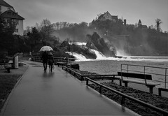 Rainy day on a river (Christof Timmermann) Tags: fuji fujilove x100f streetfotografie blackwhite blackandwhitephotography rhein rhine rheinfall schaffhausen people rainyday monochrom christof timmermann