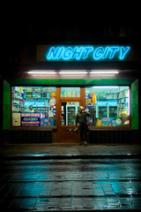 Night City (Ren-s) Tags: city ville town bruxelles brussels europe night nuit street rue shop magasin superette photography photographie couleur colors blue bleu néon neon downtown road rail tram tramway man people home gens personne goods articles belgique belgium new 2019 nouveau pavés pavement rain rainy pluie pluvieux soir evening olympus em10 lumix g