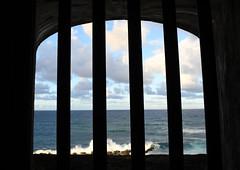 ... behind bars (pontla) Tags: sanjuan bars fortress castillo puertorico ocean waves view window behindbars castillosanfelipedelmorro
