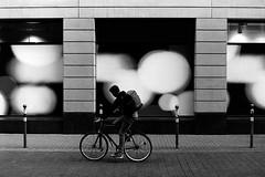 The bubble rider (Leica M6) (stefankamert) Tags: sstreet bicycle people rider bubbles film analogue analog grain lines city karlsruhe leica m6 leicam6 voigtländer nokton kodak trix stefankamert blackandwhite blackwhite noir noiretblanc