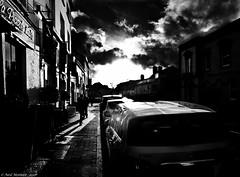 Shadows and showers (Neil. Moralee) Tags: neilmoralee shadows showers wet contrast high black white blackandwhite mono monochrome street cars boys sky clouds rain sunshine neil moralee olympus omd em5 dark noir film wales monmouth uk britain style art houses shop shops parking