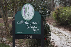 The sign for Washington Grass Inn stands right outside the entrance to Woodlawn Plantation. The main house on the property was built in 1852 by Miles Walker Lewis and is now owned by Gloria Slaughter and her husband, Wiley Slaughter.
