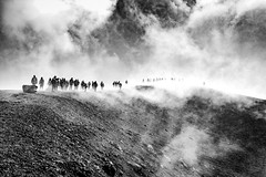 Walking on clouds [Explored] (Marc Rauw.) Tags: italië italy sicilië sicily holiday etna volcano volcanic clouds monochrome blackandwhite blackwhite black white people parade procession eery scary moody dark walking crater mountain microfourthirds m43 μ43 mzuikodigital1250mm 1250mm mzuiko olympusomdem5markii olympus omd em5 bw absoluteblackandwhite