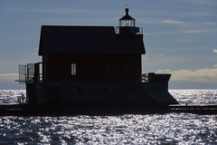 022687 Sentinel in Silhouette (David G. Hoffman) Tags: silhouettes lake lakemichigan lighthouse clouds channel