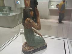 Praying Egyptian figure,     CaixaForum, Madrid, June 2018 (d.kevan) Tags: exhibitions caixaforum ancientinstruments displaycabinets june2018 madrid spain exhibits people egyptian prayingfigure