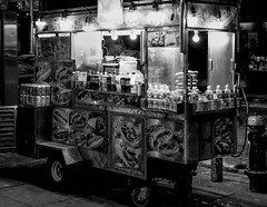 Portrait of a Street Vendor (Kenneth Laurence Neal) Tags: newyorkcity urban street streetphotography people blackandwhite monotone monochrome blackdiamond nikon nikond5200 nikon35mmf18 cities contrast environmentalportrait