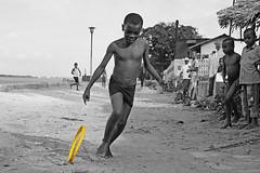 Hula Hoop (anthonyasael) Tags: activity africa african afrika amused anthonyasael barechested bicycle bike black boy cheering child children cycle eastafrica enjoying fun funny half halfnaked happiness happy horizontal indianocean joy kenya kid kids lamu leisure muslim ocean people portrait portraiture running sea shirtless smile smiling topa toy transport water wheel splashwithcolorsandhope