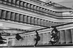 down it goes (Zesk MF) Tags: bw black white mono escalator people street candid down zesk cologne x100f fuji rolltreppe