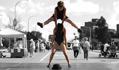 Leapfrog (Anthony Mark Images) Tags: leapfrogging girl boy dancers bojanglesdancestudios people portrait outdoors stage street monochrome blackandwhite selectivecolour bestival belmontstreetfestival kitchener ontario canada blackcostumes blackhat danceroutine fun comical children nikon d850 leap