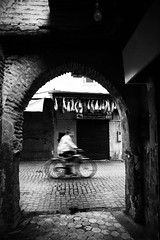 Looking for light in a dark city~ Marrakech (~mimo~) Tags: medina urban city arch plants loofah bicycle blur motion africa berber magreb marrakech mimokhairphotography morocco northafrica photography street travel