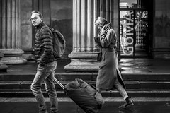 The Traveller (Leanne Boulton (Away)) Tags: urban street candid portrait streetphotography candidstreetphotography candidportrait eyecontact candideyecontact streetlife motion action movement man woman male female walking travelling transit suitcase backpack face eyes expression mood feeling atmosphere architecture column steps tone texture detail depthoffield bokeh naturallight outdoor light shade shadow city scene human life living humanity society culture lifestyle people canon canon5dmkiii 70mm ef2470mmf28liiusm black white blackwhite bw mono blackandwhite monochrome glasgow scotland uk