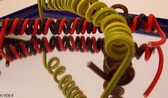 More Spirals (björnvandenbulcke) Tags: smileonsaturday spirals spiegel spiegelbeeld kleuren geelgroen rood zwart bruin blauw elektrische draden
