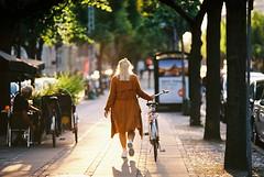 Girl walking on Frederiksberg Allé on a summer day. Taken with Kodak Ektar 100 + Canon EOS 650 + Canon EF 135mm f2 (Kristoffer Trolle) Tags: analogfilm copenhagen denmark bicycle kodakektar100 girl pige cykel bike relax relaxing frederiksberg danmark københavn canoneos650 canonef135mmf20usm