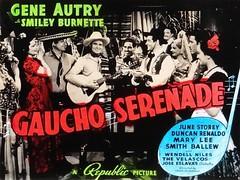 """Gaucho Serenade"" (Republic Pictures, 1940), starring the Singing Cowboy, Gene Autry.  Lantern Slide Image of the lobby card. (lhboudreau) Tags: movieitem lanternslide movieposter motionpicture western wildwest cowboy cowboys cowboyhero westernhero cowboyfilm classicwestern cowboymovie republicpicture republicpictures 1940 gauchoserenade geneautry smileyburnette duncanrenaldo junestorey marylee smithballew wendellniles thevelascos joseeslavas frankmcdonald singingcowboy guitar slide titlecard lobbycard color people autry"