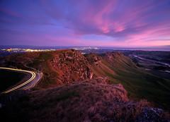 Arrival of Light to the Peak (ajecaldwell11) Tags: xe3 carlights sunrise ankh purple dawn orange clouds sun hawkesbay newzealand pink sky tematapeak caldwell fujifilm light