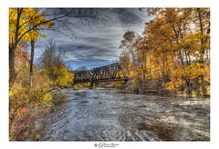 The Wilton, NH Railway (Pearce Levrais Photography) Tags: railway bridge river stream water whitewater rapids foilage fall autumn autumnal autumnleaves trees sky cloud canon hdr picoftheday photooftheday explore nh newhampshire landscape beautiful greatshot newengland leafpeeping leaf metal stone iron