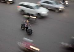A brave vendor. (DepictingPhotos) Tags: asia hanoi motionblur street usa vendors vietnam happyplanet asiafavorites