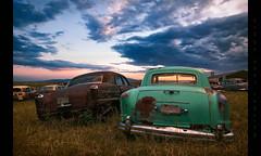 Homeward Bound (Whitney Lake) Tags: sunset clouds sky goldenhour colorado frazer kaiser junkyard junk decay rust car abandoned
